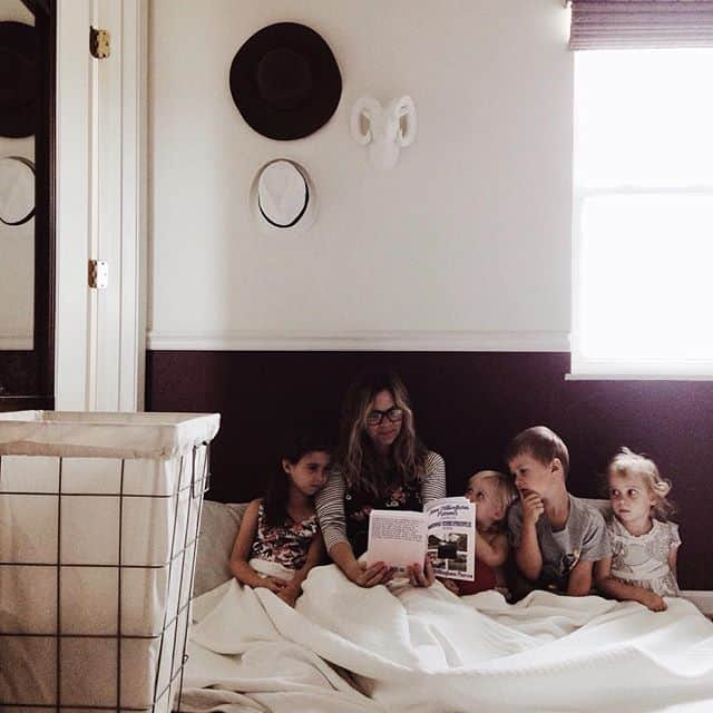 mom reading to her kids on the floor