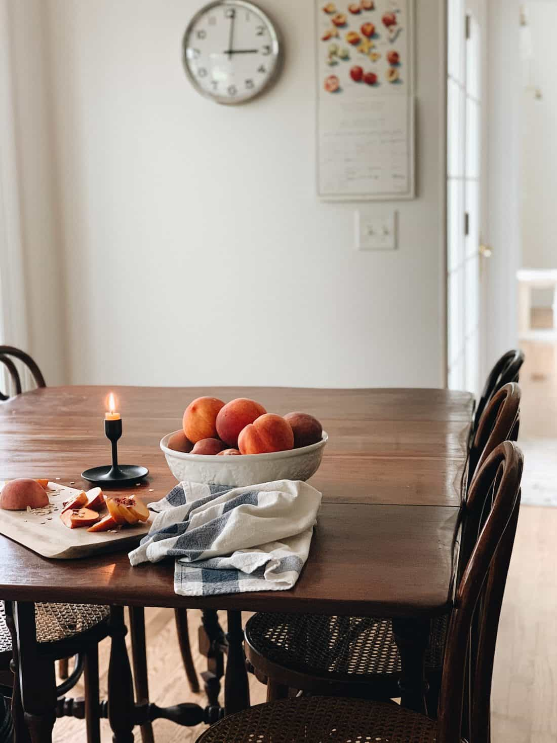 why to decorate with antique wooden table and bentwood chairs with peaches on top in a white bowl