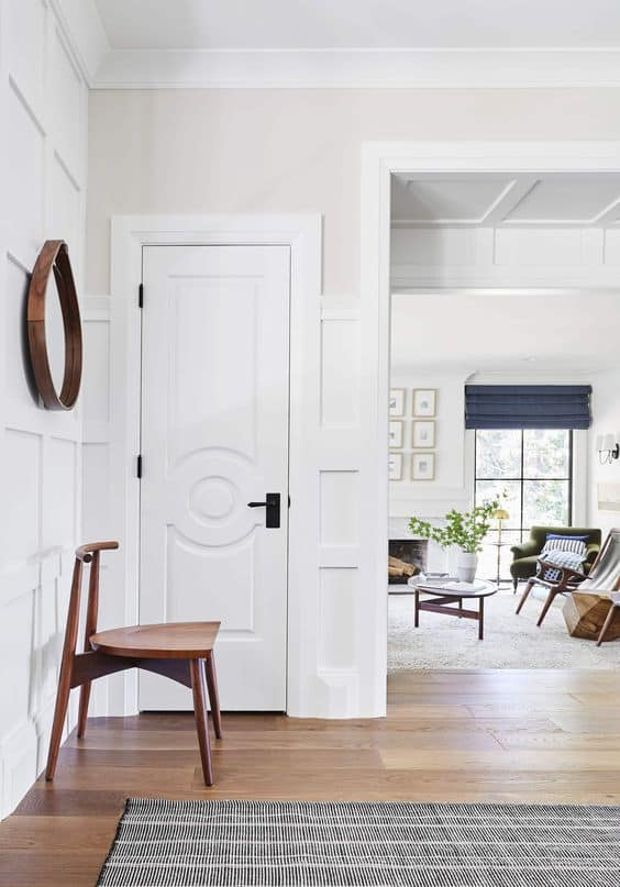 pure white by sherwin williams on woodwork of an entryway