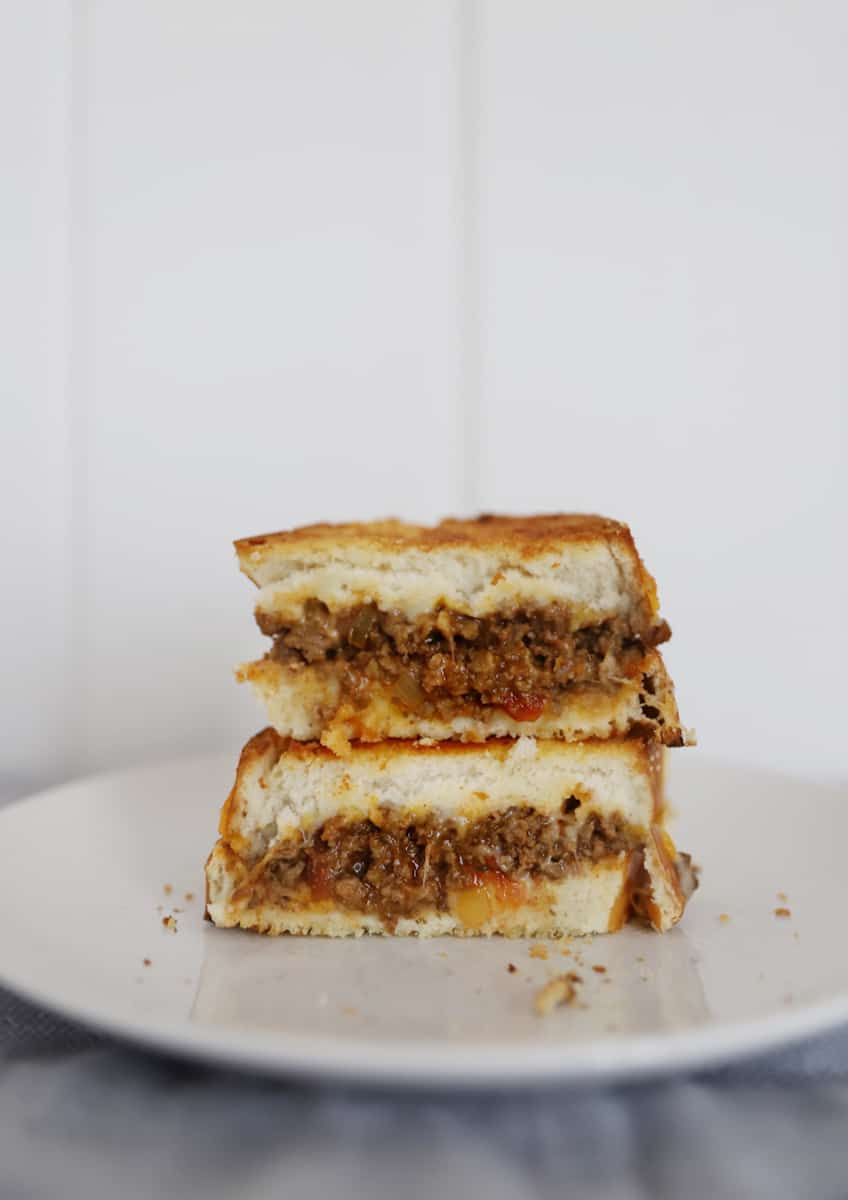 taco grilled cheese on a white plate