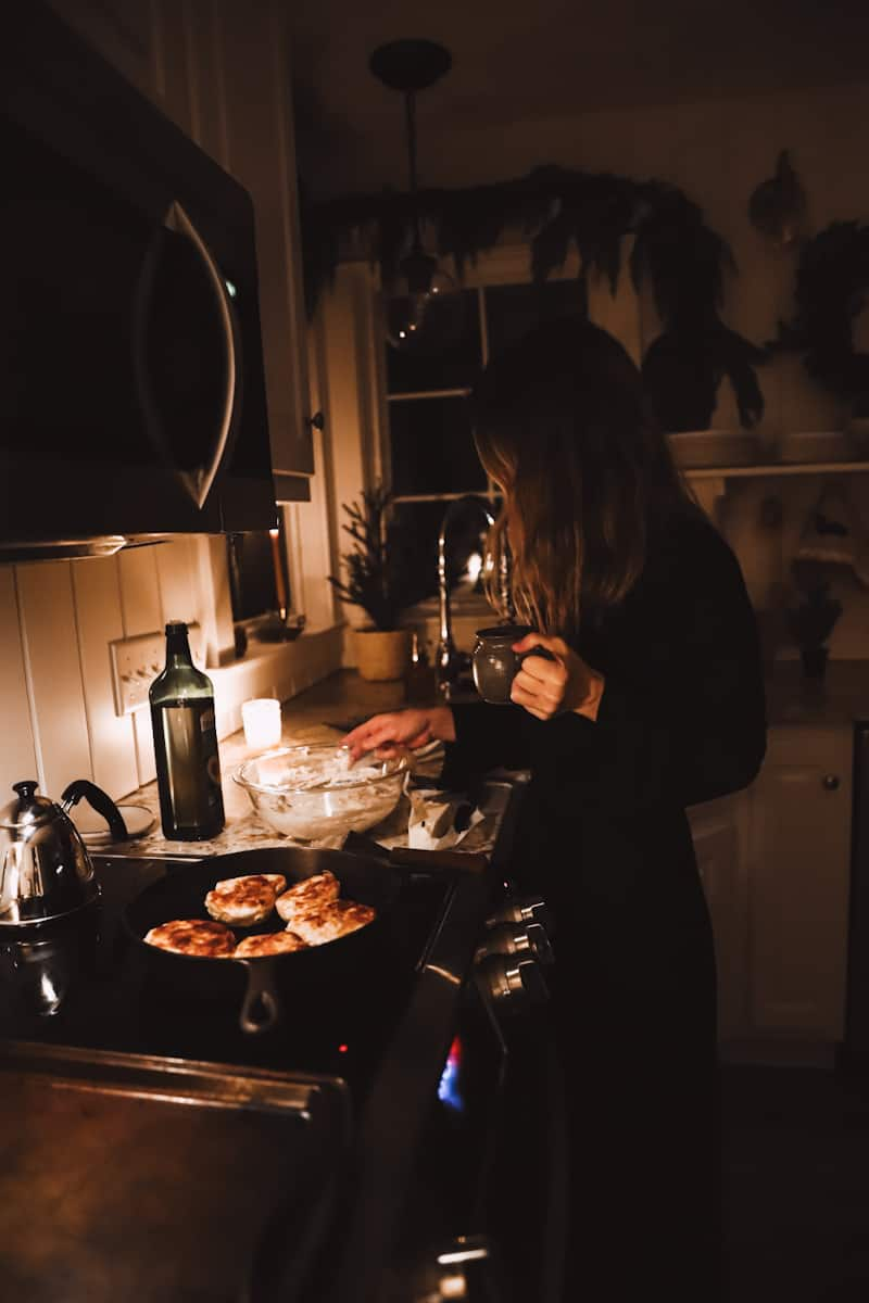 mother fixing breakfast in the dark winter with pajamas on