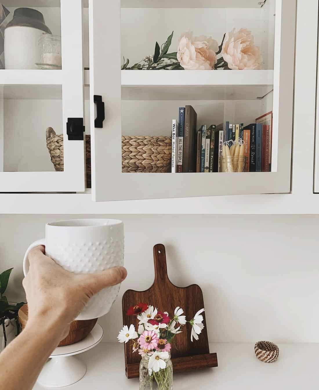 coffee cup in front of built in cabinets