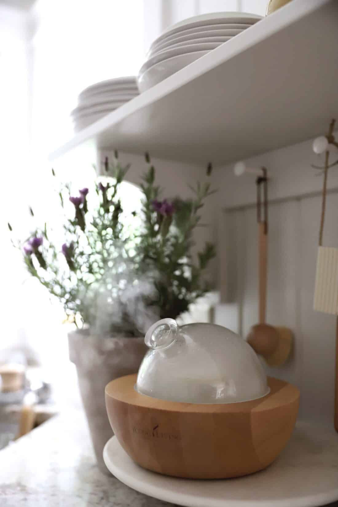 essential oil mist pouring out of aria diffuser