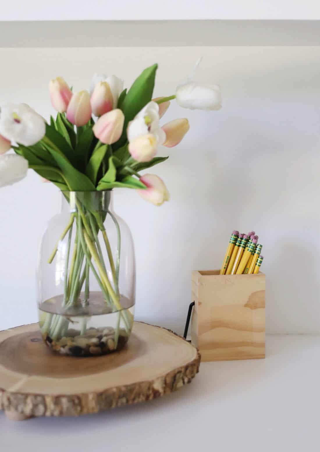 tulips and homeschool pencils in a wooden jar