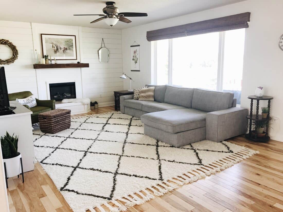 a living room with horizontal DIY shiplap and fireplace