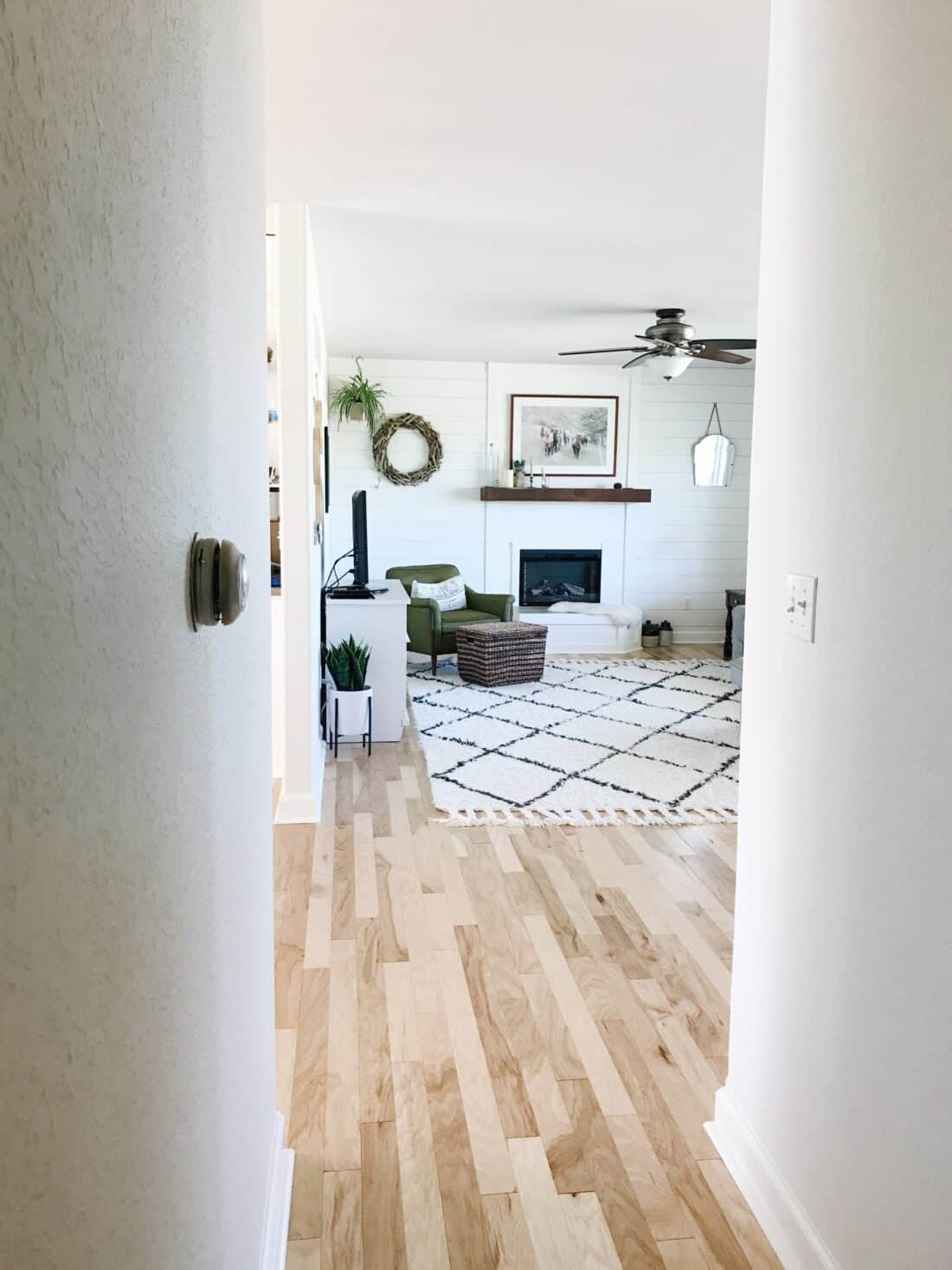 horizontal shiplap on living room walls around a fireplace