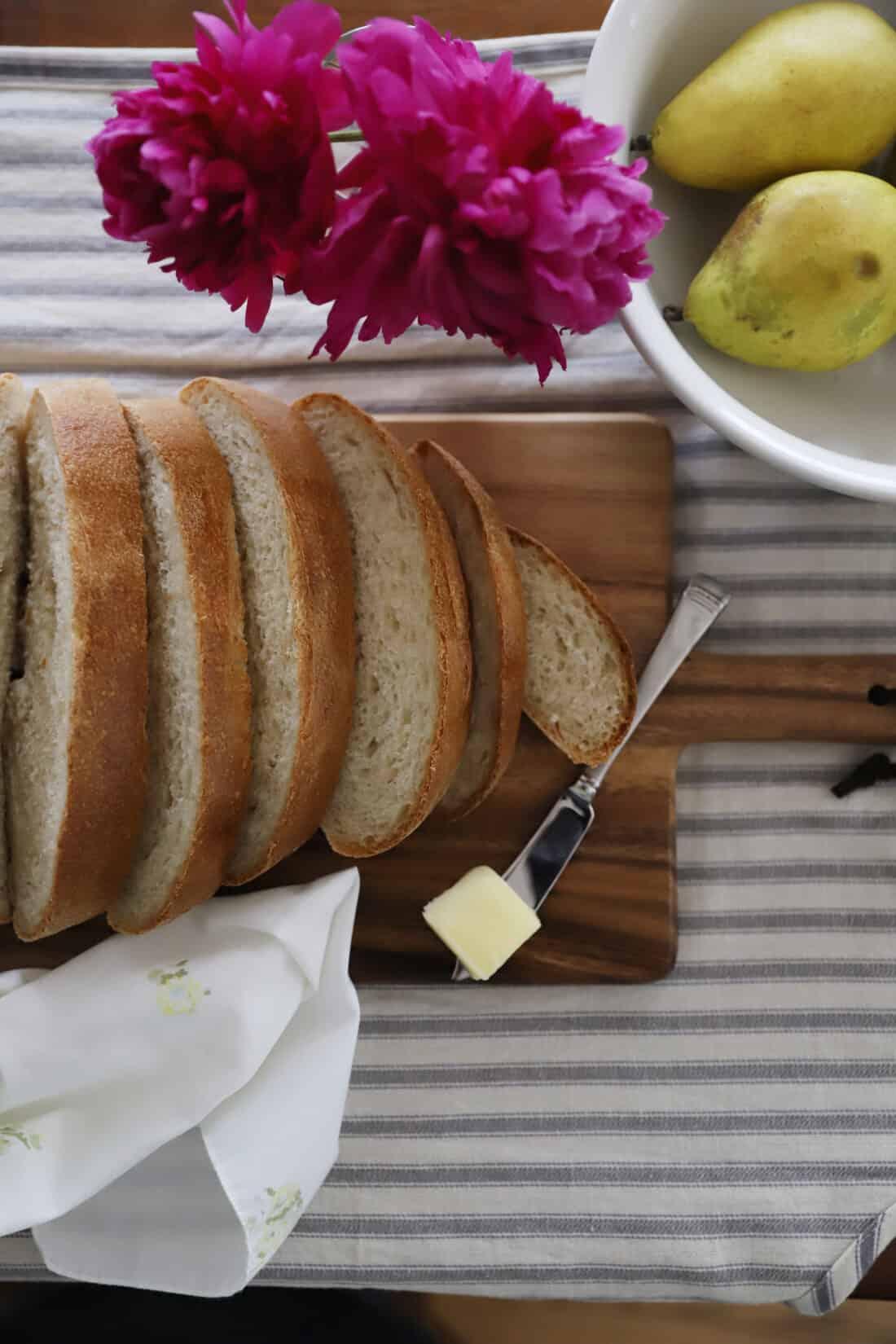 sliced sourdough french bread on a cutting board