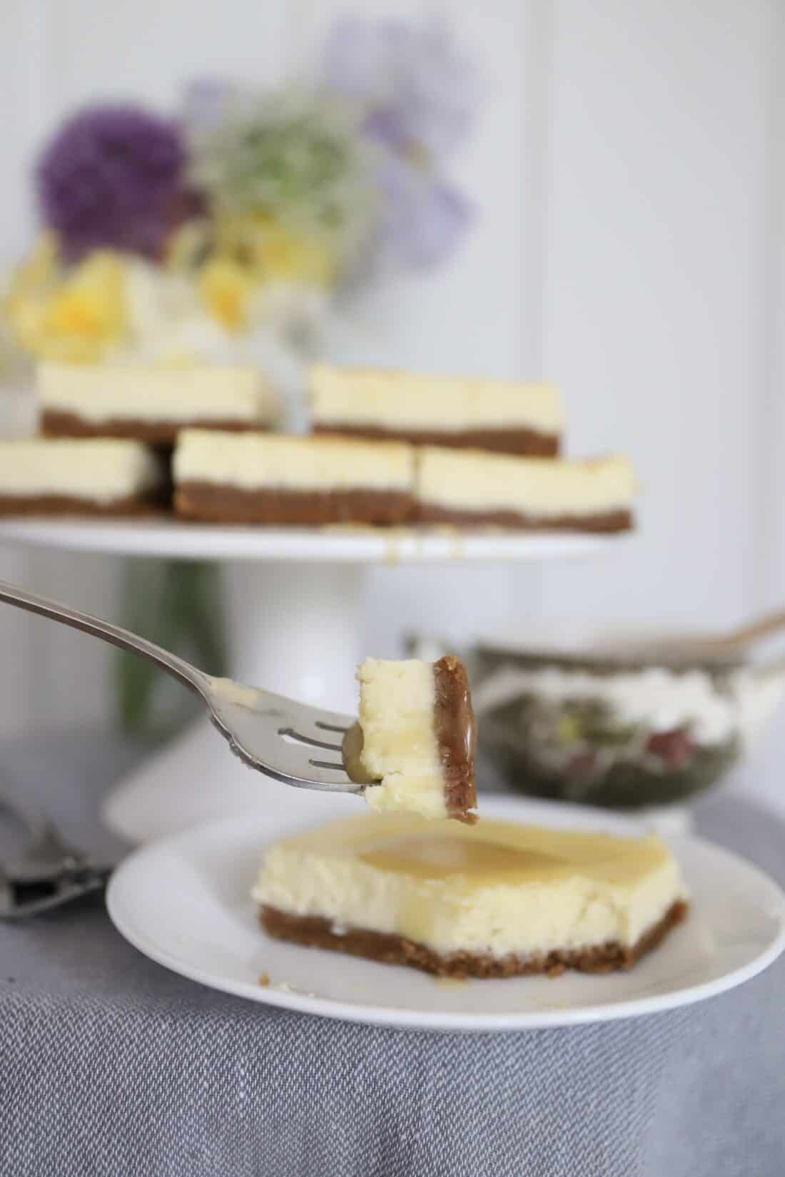 a bite of cheesecake without a springform pan on a fork about to be eaten