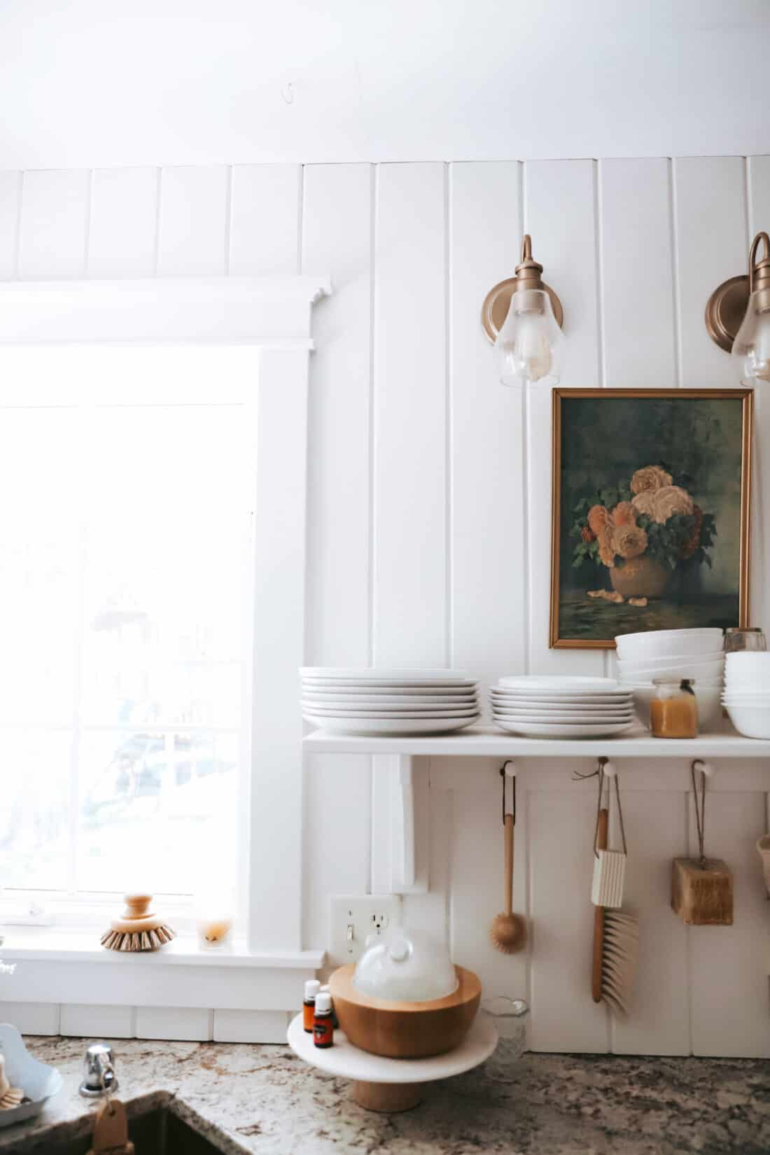 vertical shiplap boards used as shiplap kitchen backsplash painted in snowbound paint by sherwin williams