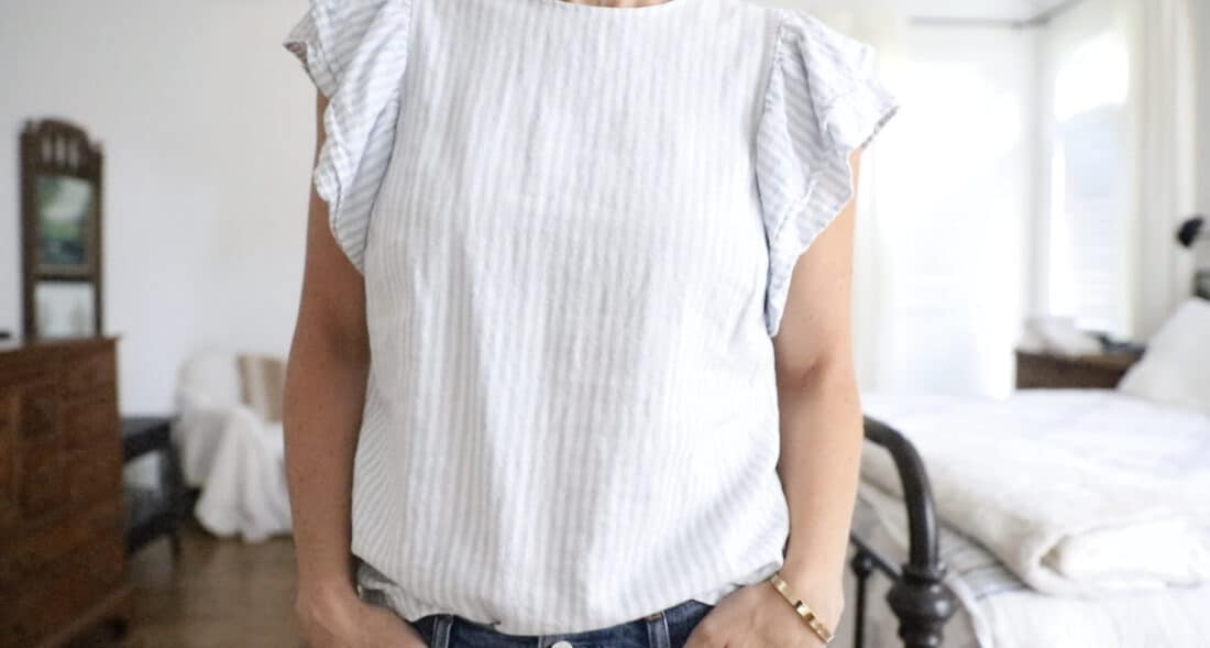mom wearing a blue and white striped blouse with butterfly sleeves