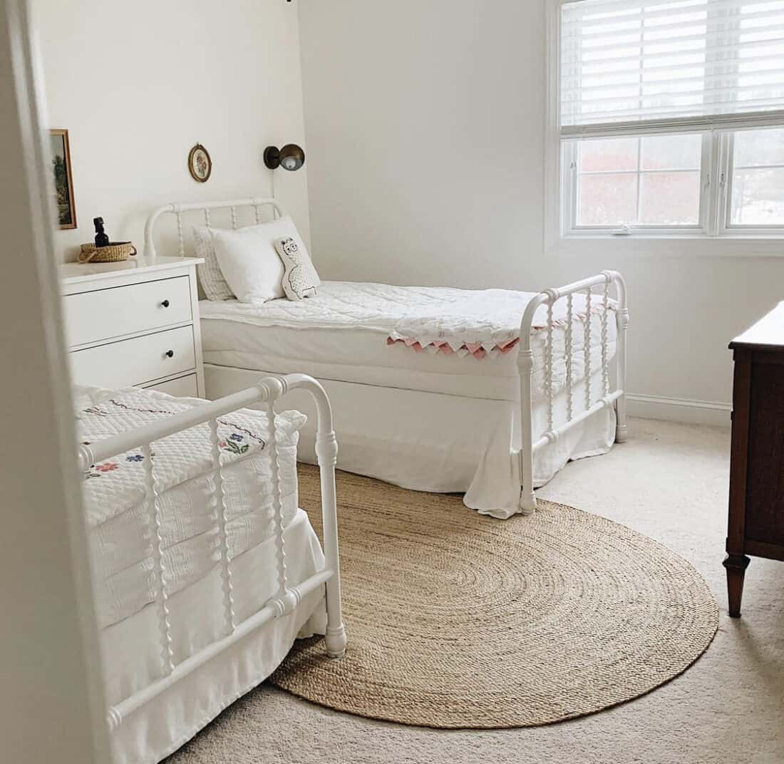 an oval woven jute rug in a child's room