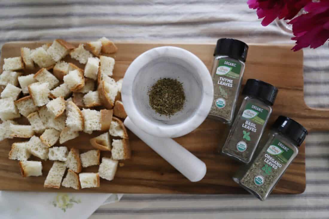 easy sourdough italian croutons from scratch seasonings on a cutting board