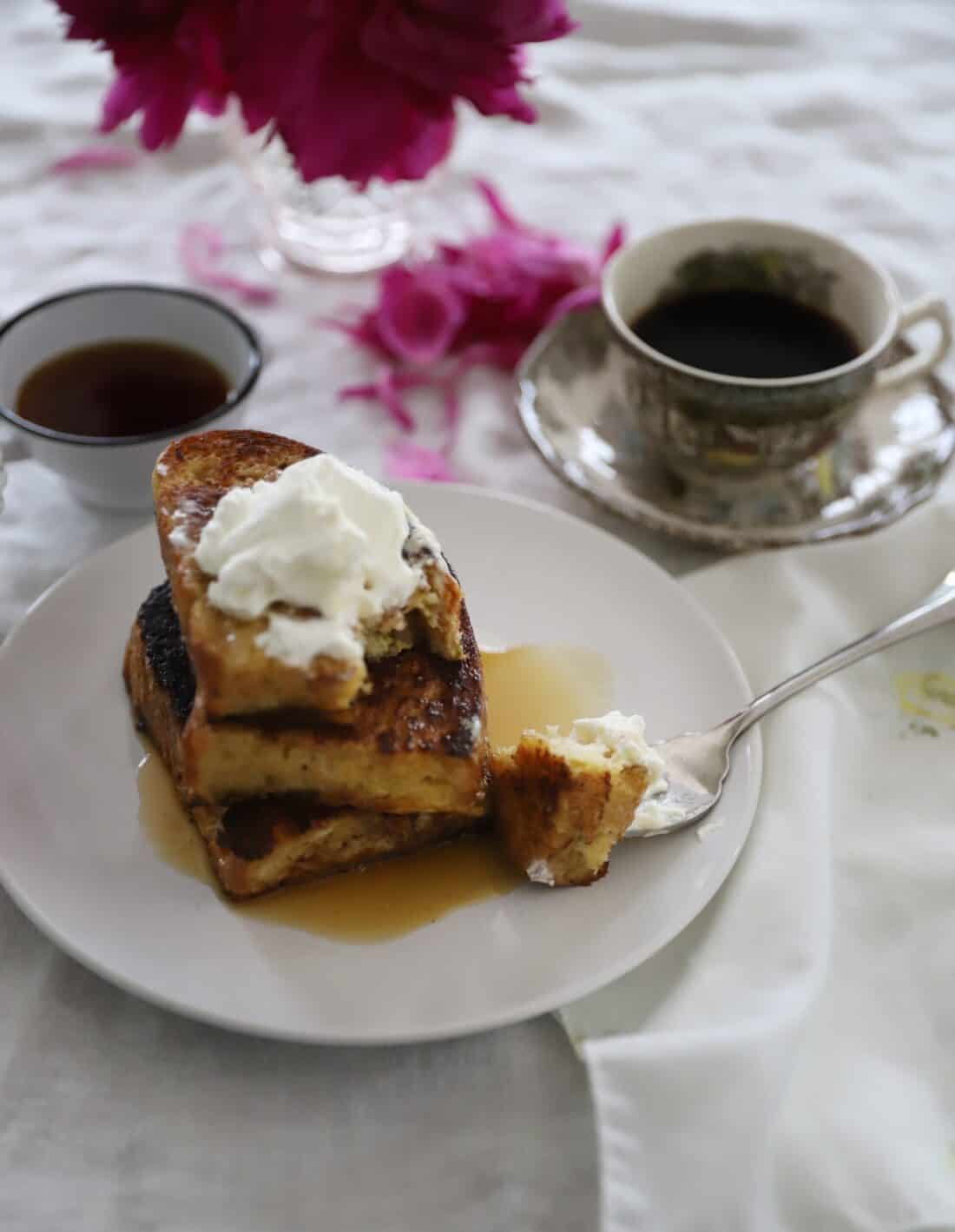 1 inch sourdough french toast slices on a white plate