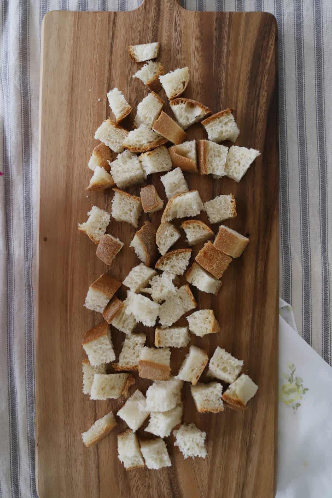 easy sourdough italian croutons from scratch diced bread on a cutting board