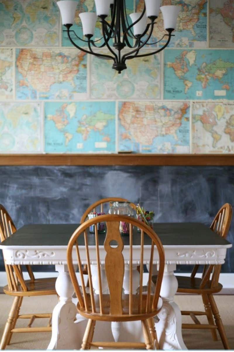 a homeschool room with a map wall and a DIY chalkboard