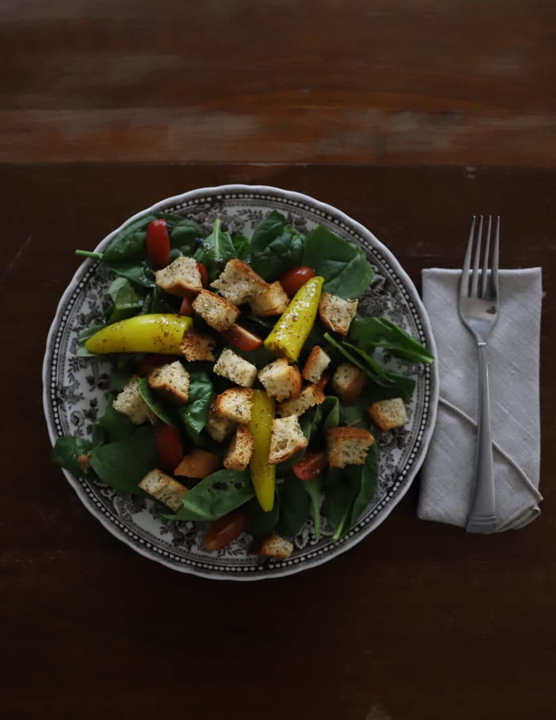 easy sourdough italian croutons from scratch on a green salad