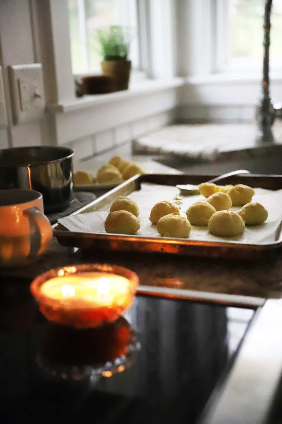 unfilled cream puffs cooling in a cottage kitchen