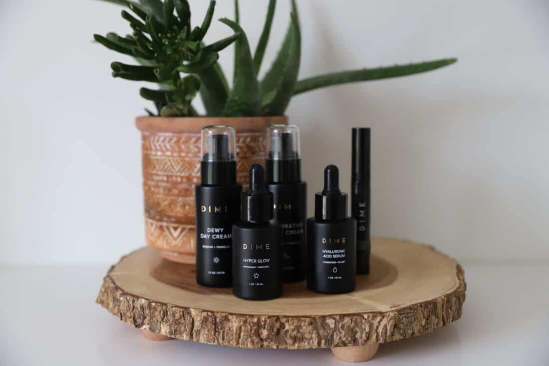 skin care products for women on a wooden stand