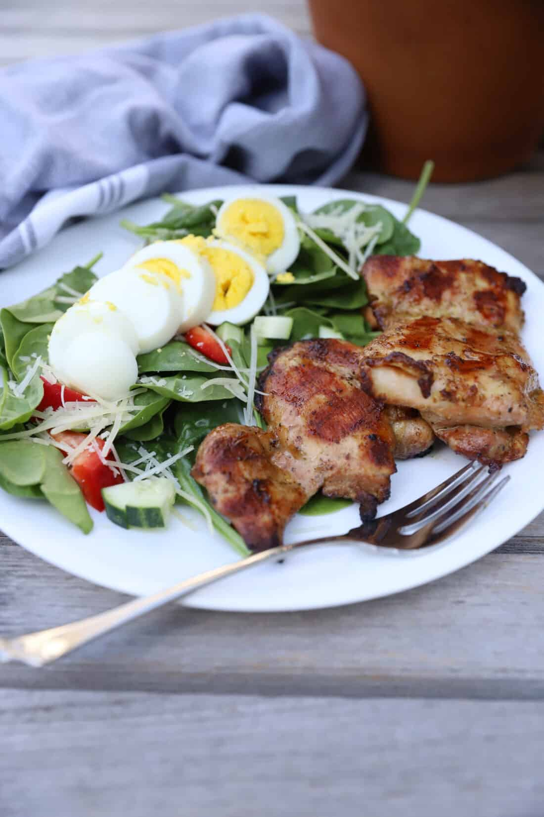 Grilled Smoked Chicken Thighs with a side salad
