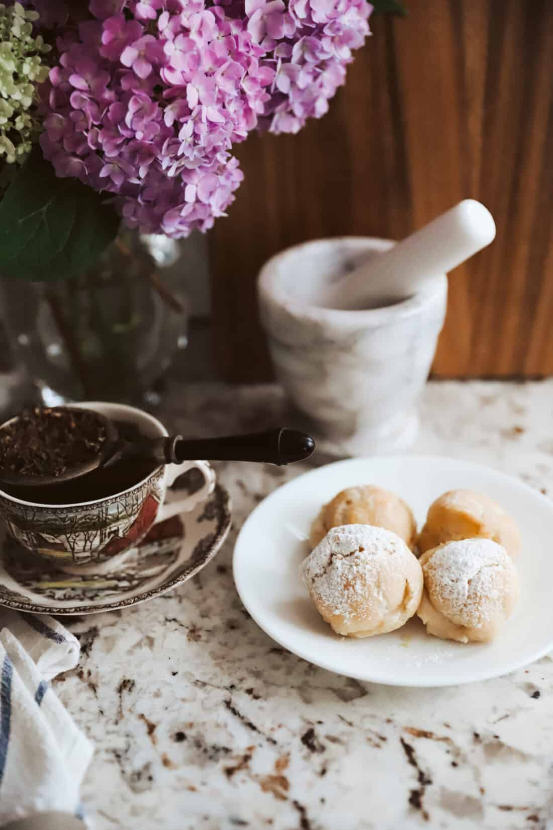old fashioned cream puffs and a cup of tea