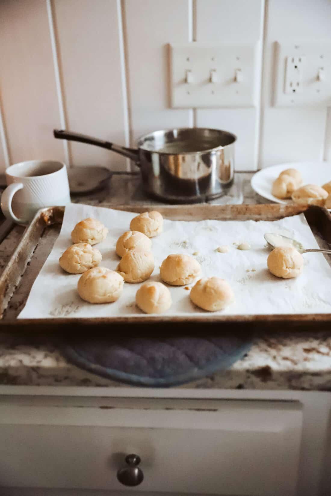 cream puffs being filled with custard