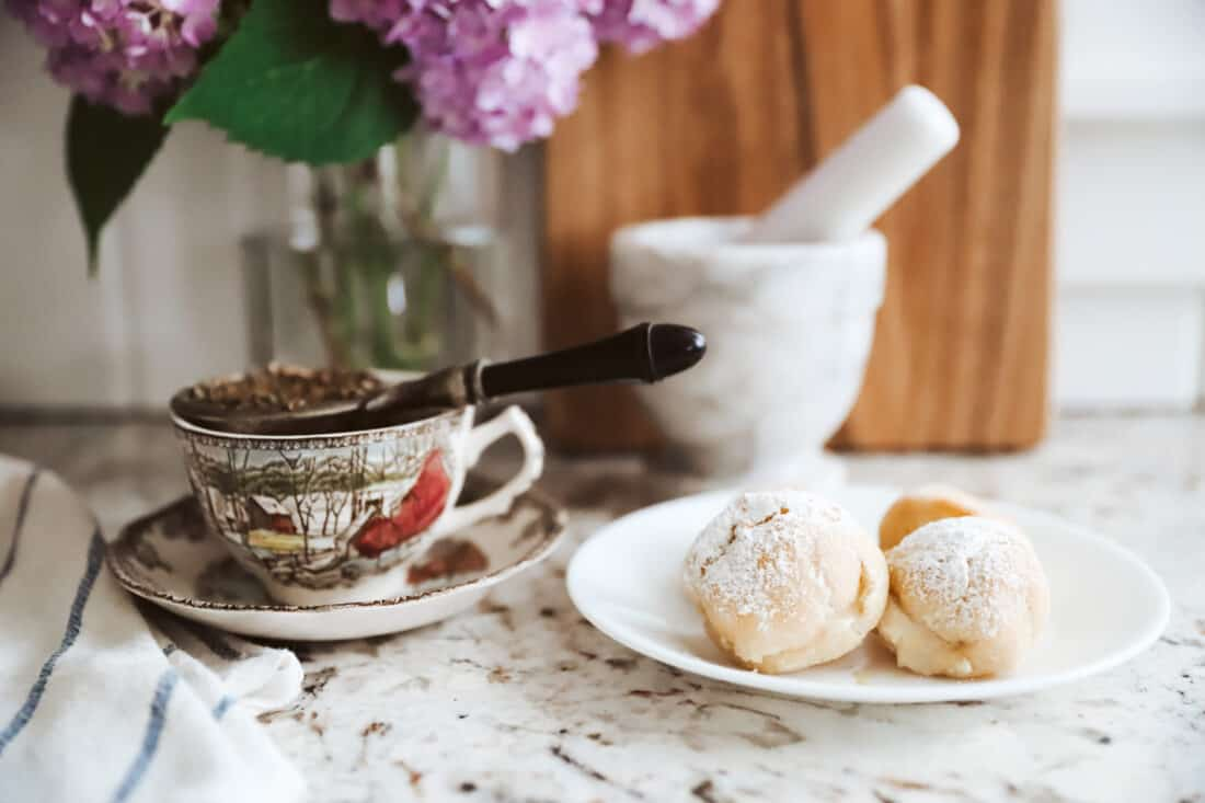 cream puffs and a cup of afternoon tea
