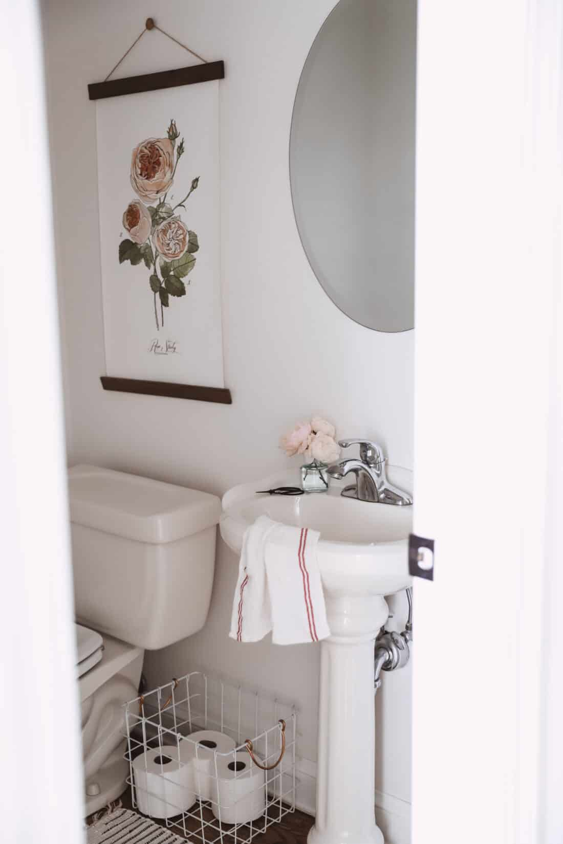 a clean bathroom with roses