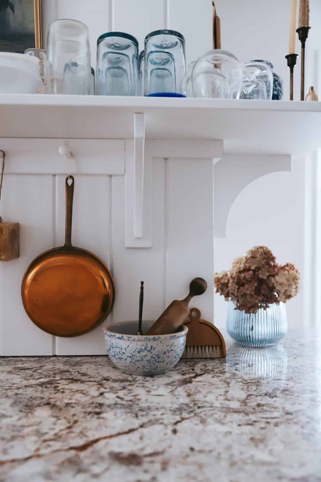 white vertical shiplap in a cottage kitchen with glasses