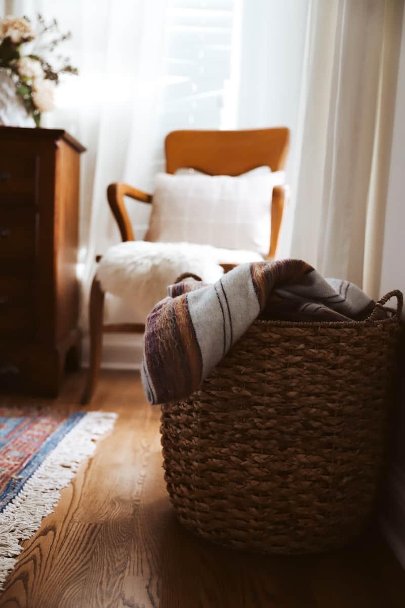 a wicker basket full of blankets