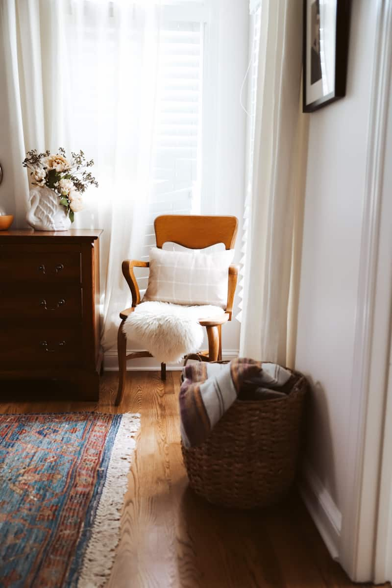 wooden chair in front of a window