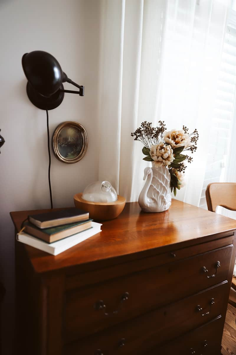 faux flowers for fall on a night stand