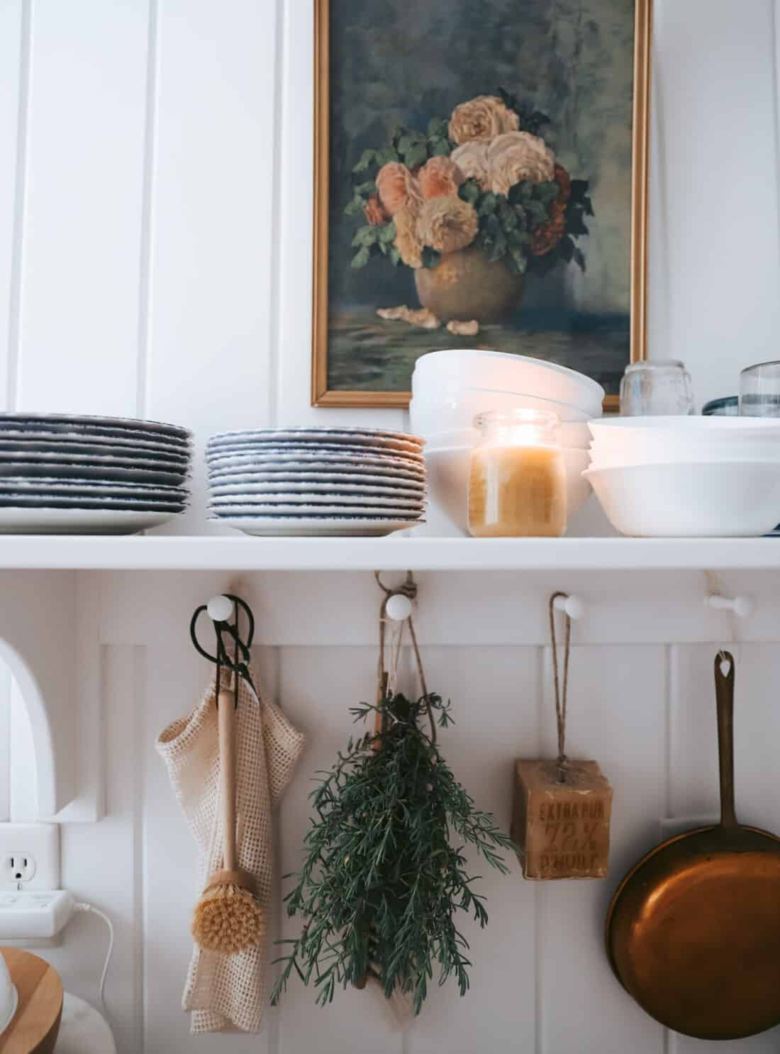 white vertical shiplap in a cottage kitchen with hanging herbs