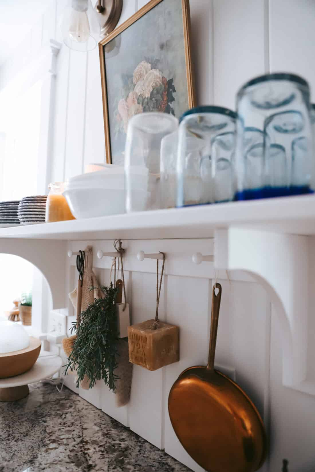 white vertical shiplap in a cottage kitchen with open shelving