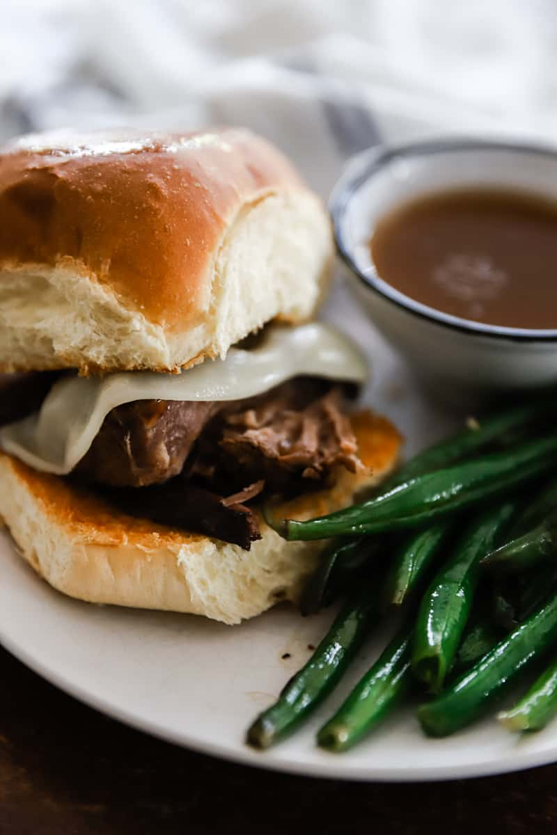 french dip sandwich with green beans and french roll