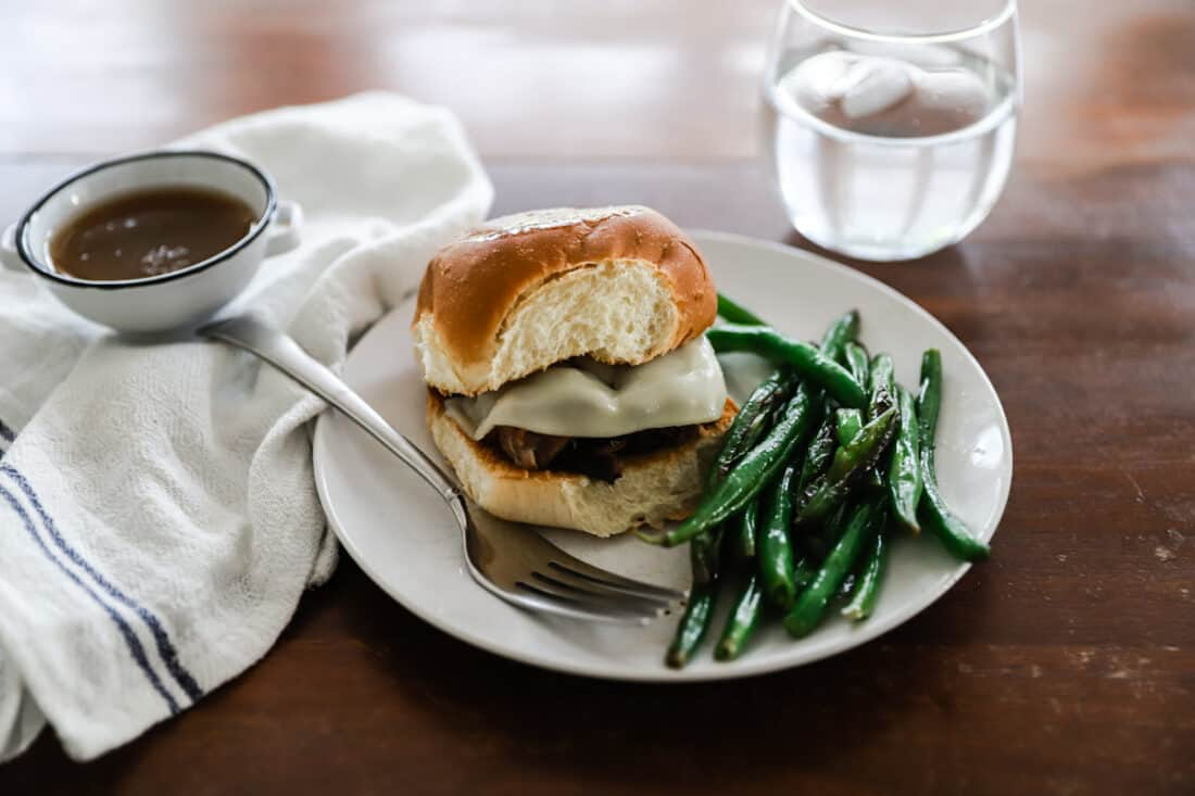 french dip sandwich with green beans with cheese
