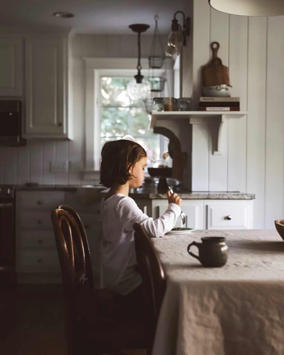 child eating breakfast in the morning