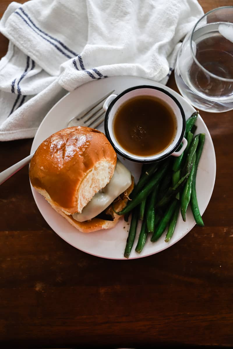 french dip sandwich with green beans with au jus