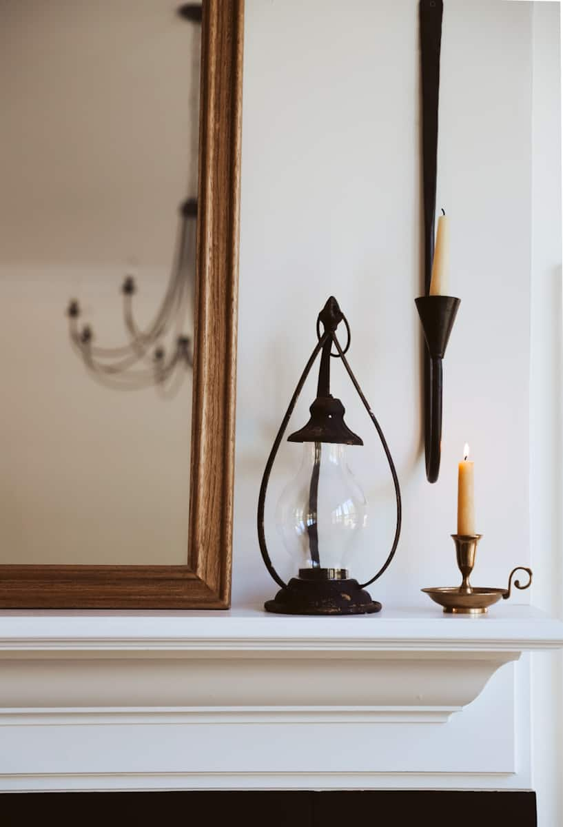 candles and lanterns on mantel