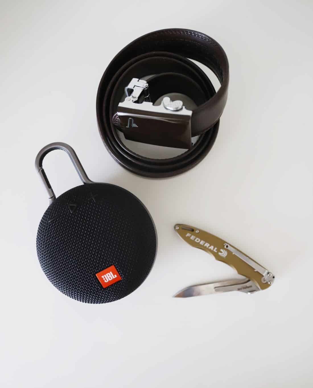 belt speaker and knife on a white counter
