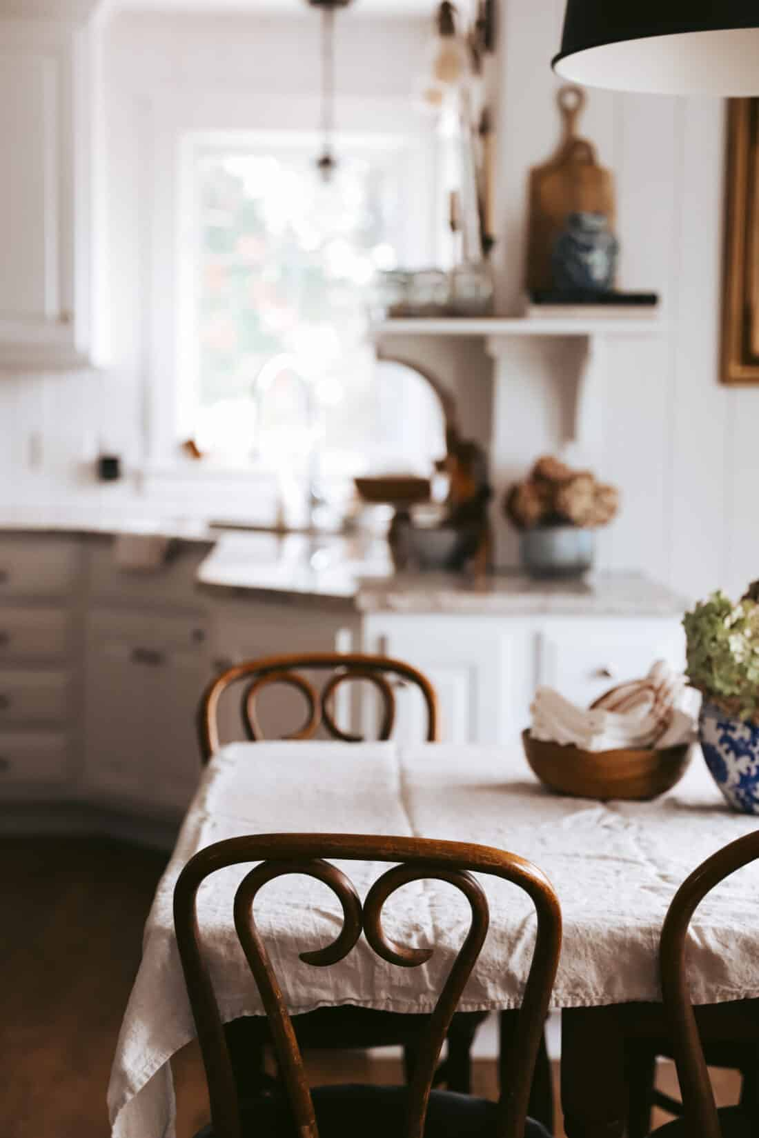 white vertical shiplap in a cottage kitchen with a tablecloth on a table