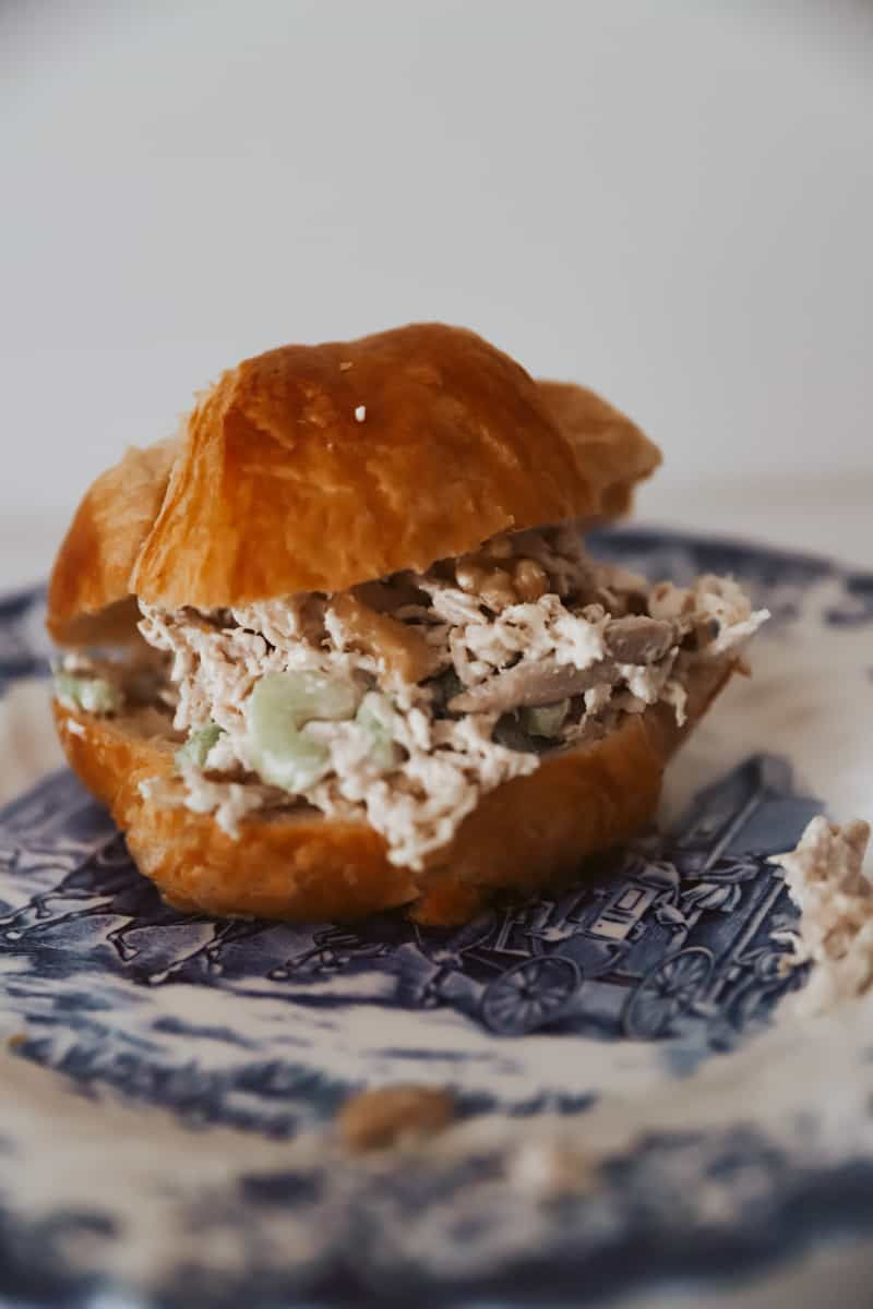 chicken salad on a blue and white vintage plate