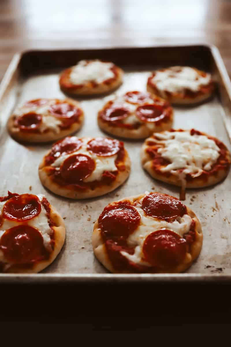 individual pizzas on a pan